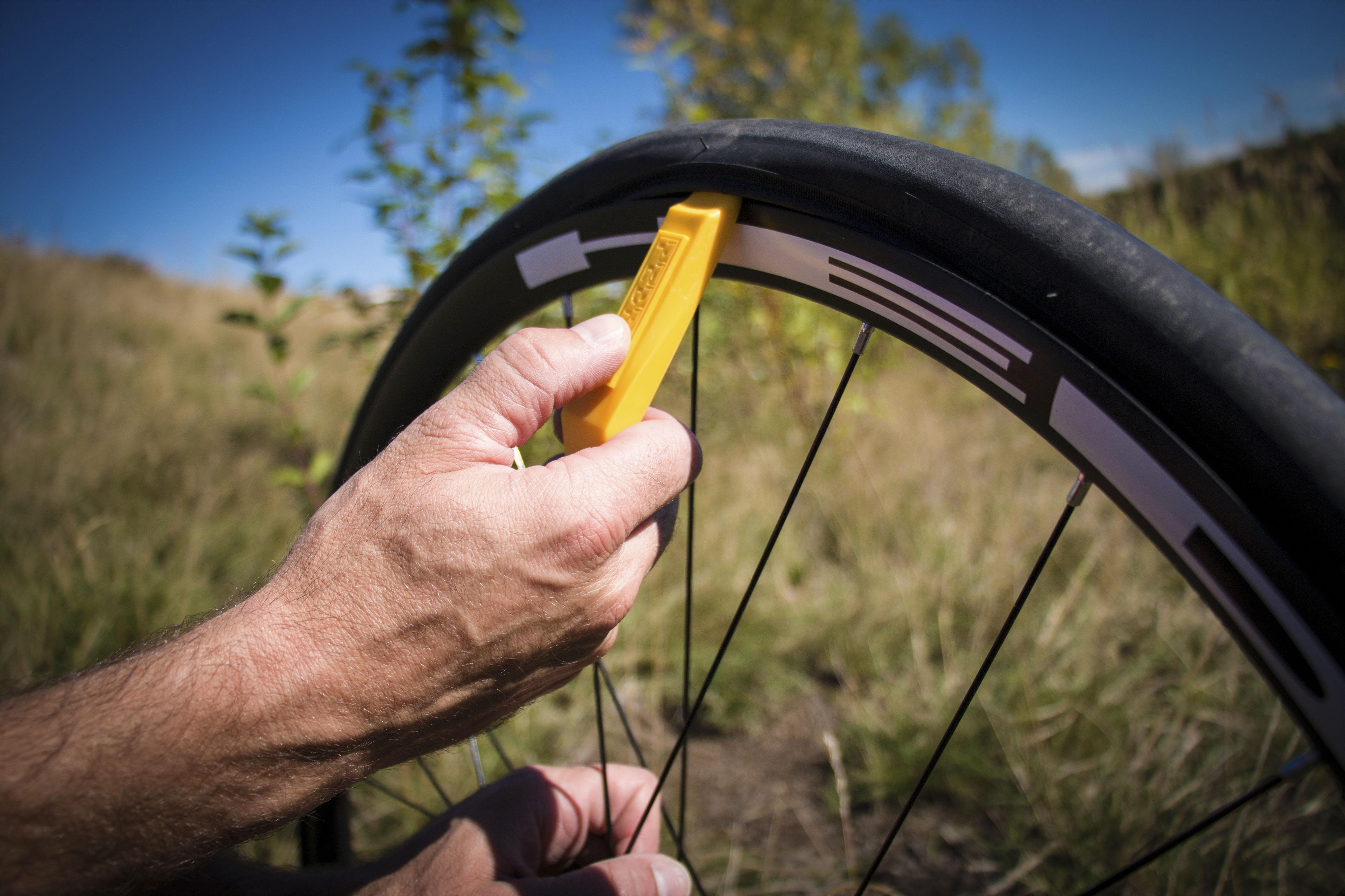 start opposite the tire valve