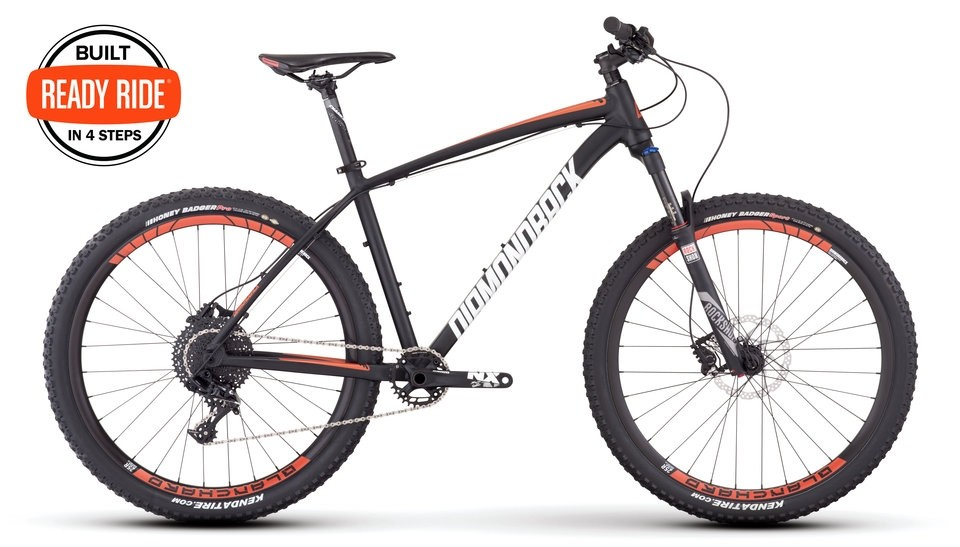 Overdrive Pro 27.5 black mountain bike with orange accents and white decals