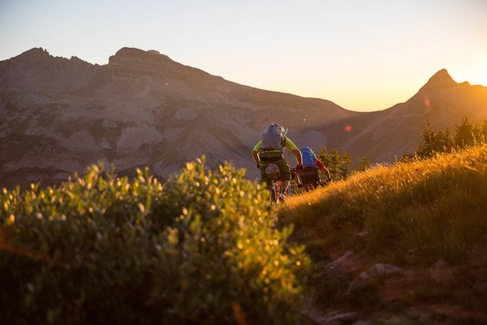 Riding through mountain field